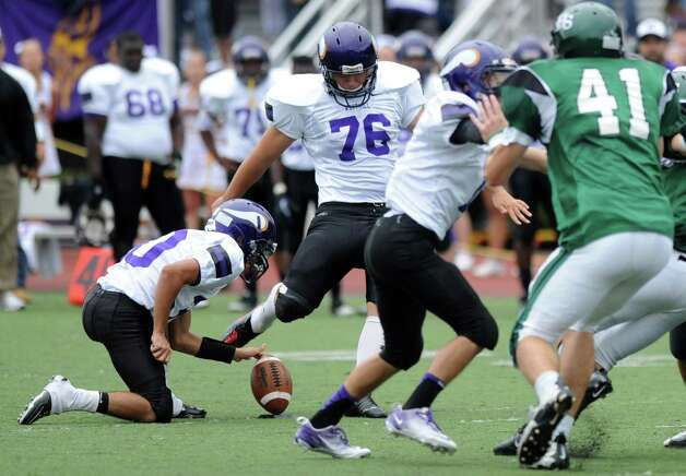 Westhill's Bernard Buzz attempts a field goal at the end of the second quarter of Saturday's football game against Norwalk High School at Westhill High School on September 29, 2012. Photo: Lindsay Niegelberg / Stamford Advocate