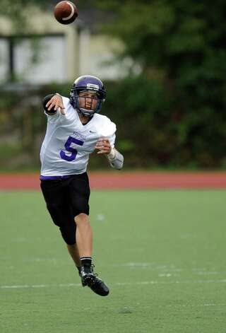 Westhill's Ryan Cappola throws a pass during Saturday's football game against Norwalk High School at Westhill High School on September 29, 2012. Photo: Lindsay Niegelberg / Stamford Advocate