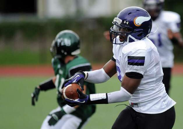 Westhill's Moise Francillon carries the ball during Saturday's football game against Norwalk High School at Westhill High School on September 29, 2012. Photo: Lindsay Niegelberg / Stamford Advocate