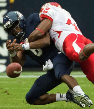 UH 35, Rice 14Rice quarterback Driphus Jackson (6) fumbles as he is sacked by Houston linebacker Phillip Steward (42) during the first quarter of the annual Bayou Bucket college football game at Reliant Stadium, Saturday, Sept. 29, 2012, in Houston. Photo: Smiley N. Pool, Houston Chronicle / © 2012  Houston Chronicle