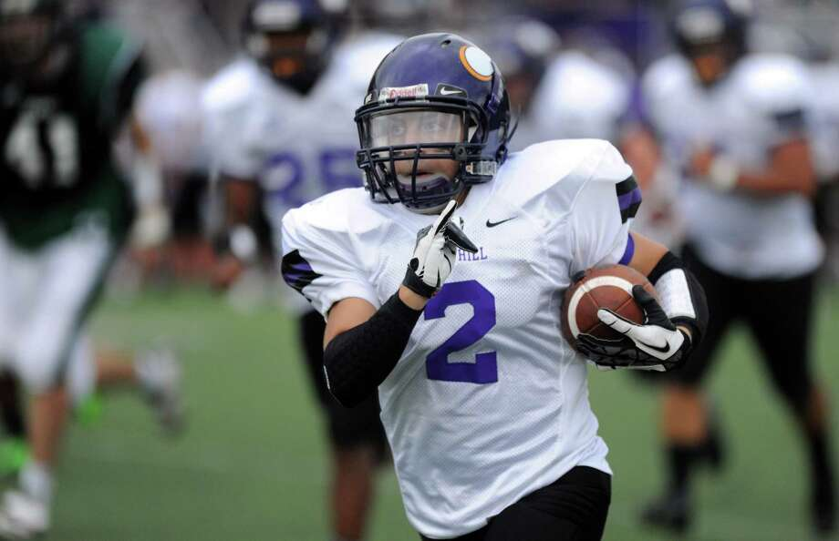 Westhill's Sean Remomdino carries the ball during Saturday's football game against Norwalk High School at Westhill High School on September 29, 2012. Photo: Lindsay Niegelberg / Stamford Advocate