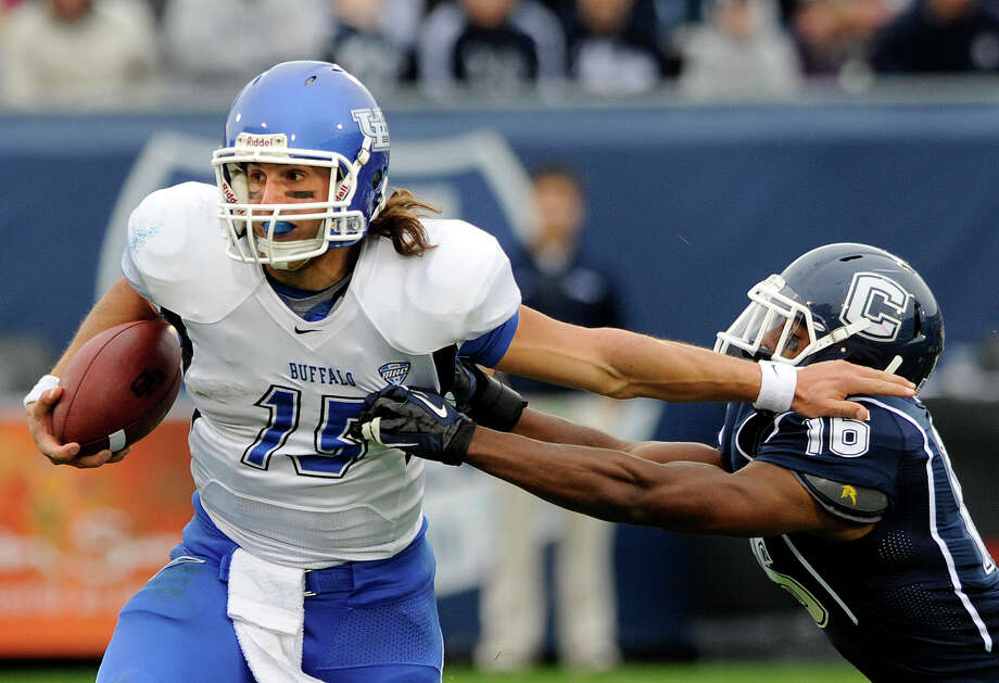 Connecticut's Byron Jones, right, tries to tackle Buffalo's Alex Zordich during the first half of their NCAA college football game in East Hartford, Conn., on Saturday, Sept. 29, 2012. (AP Photo/Fred Beckham) Photo: Fred Beckham, Associated Press / FR153656 AP