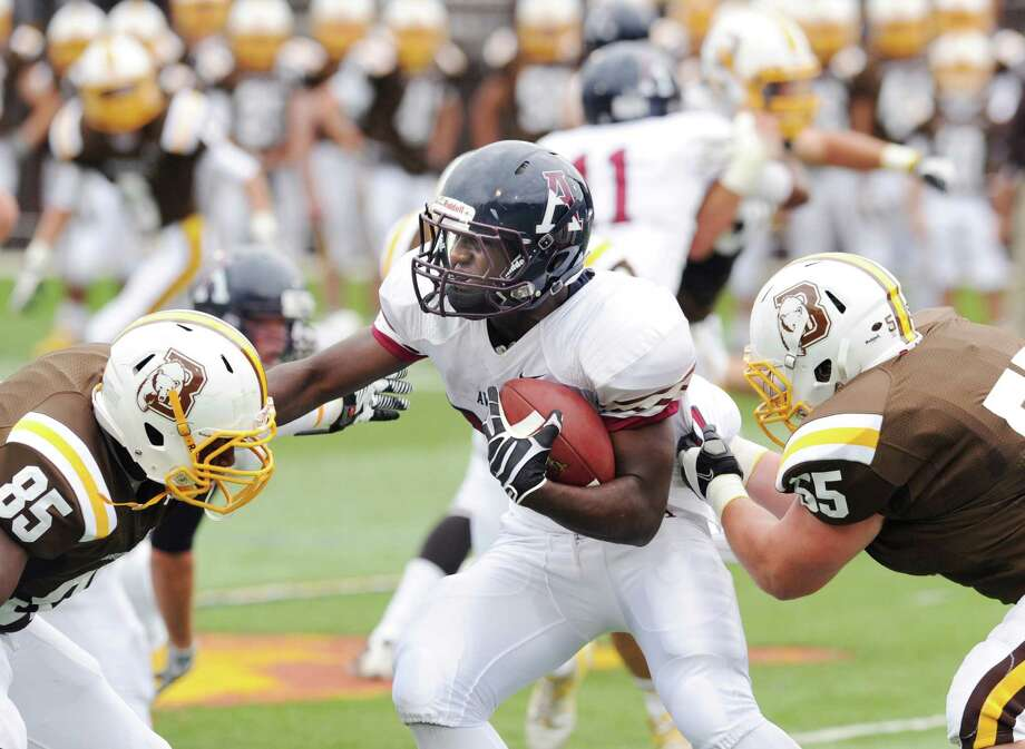 Avon Old Farms running back Mickoy Nichol , center, gets sandwiched by Brunswick defenders, Dylan Wadsworth, left, # 85, and Will Rosato, # 55, during the high school football game between Brunswick School and Avon Old Farms School at Brunswick in Greenwich, Saturday afternoon, Sept. 29, 2012. Photo: Bob Luckey / Greenwich Time