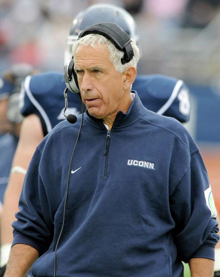 Connecticut coach Paul Pasqualoni reacts during the first half of his team's 24-17 victory over Buffalo in an NCAA football game in East Hartford, Conn., on Saturday, Sept. 29, 2012. (AP Photo/Fred Beckham) Photo: Fred Beckham, Associated Press / FR153656 AP