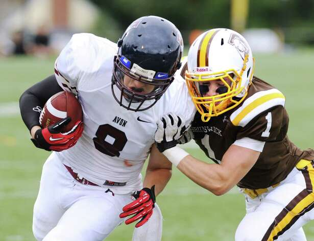 Sam Fraser # 1 of Brunswick tackles wide receiver Chris Clark # 8 of Avon Old Farms high school football game between Brunswick School and Avon Old Farms School at Brunswick in Greenwich, Saturday afternoon, Sept. 29, 2012. Photo: Bob Luckey / Greenwich Time