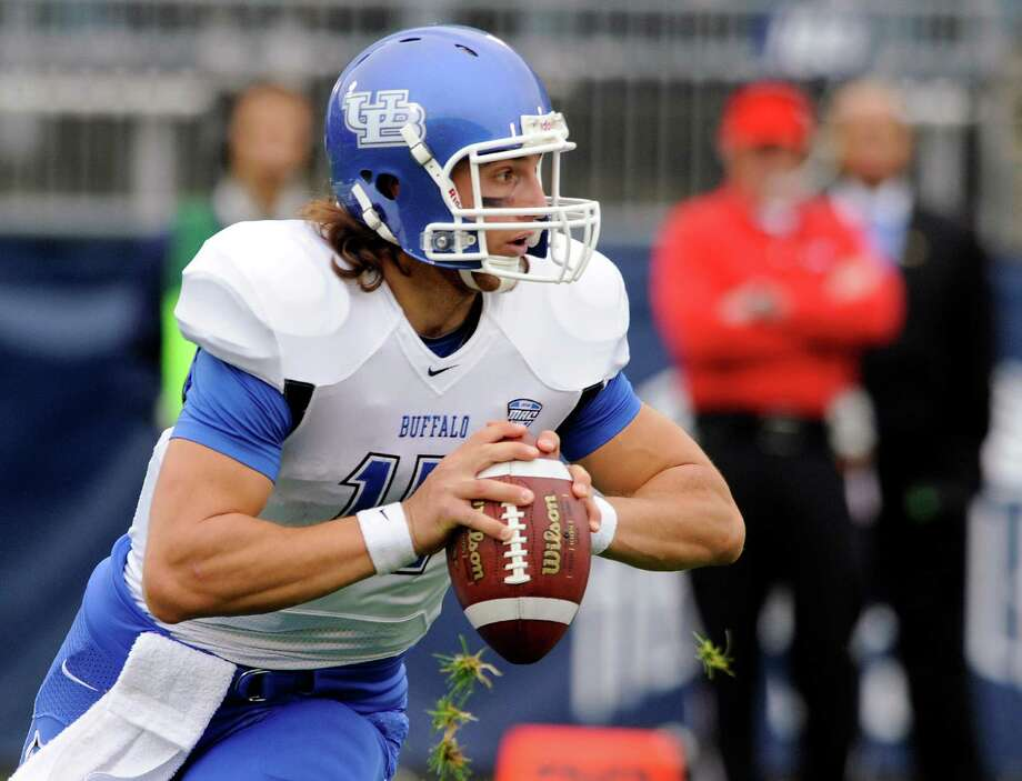 Buffalo's Alex Zordich looks downfield during the first half of his team's 24-17 loss to Connecticut in their NCAA college football game in East Hartford, Conn., on Saturday, Sept. 29, 2012. (AP Photo/Fred Beckham) Photo: Fred Beckham, Associated Press / FR153656 AP