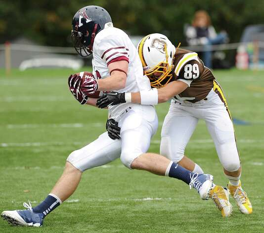 At right, Jack Varvel # 89 of Brunswick School makes a tackle during the high school football game between Brunswick School and Avon Old Farms School at Brunswick in Greenwich, Saturday afternoon, Sept. 29, 2012. Photo: Bob Luckey / Greenwich Time