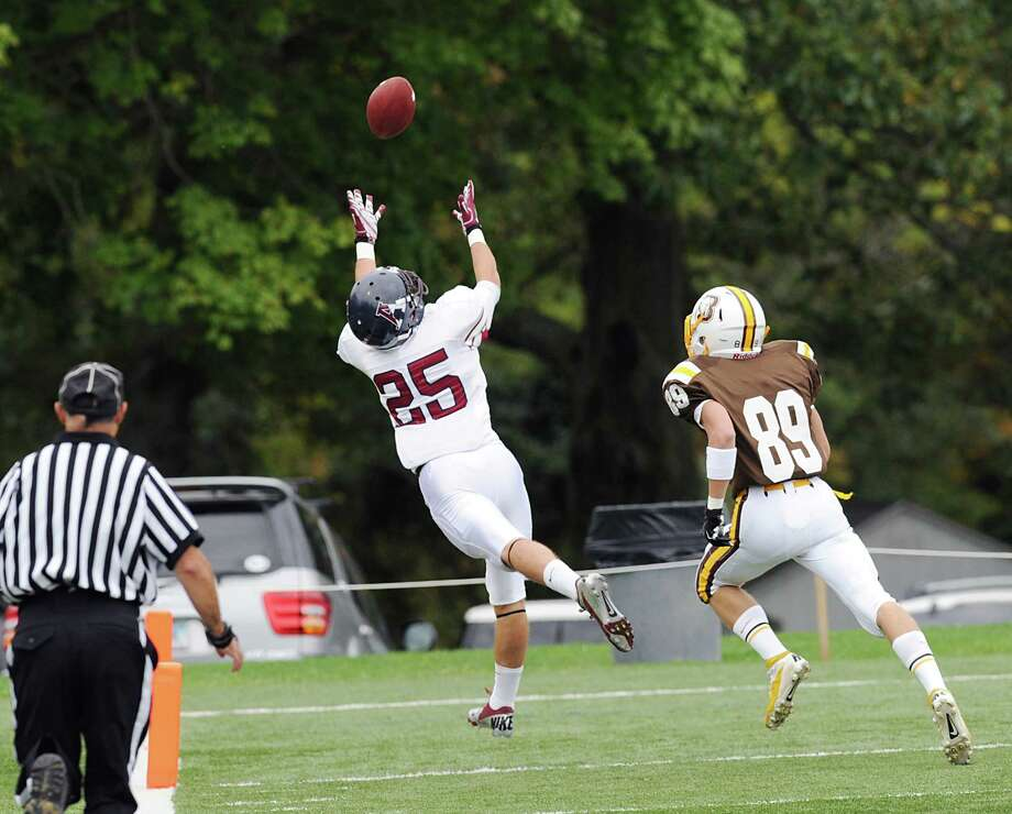 At left, Taylor Barthelette # 25 of Avon Old Farms scores on a reception beating Brunswick's Jack Varvel # 89 during first quarter action in the high school football game between Brunswick School and Avon Old Farms School at Brunswick in Greenwich, Saturday afternoon, Sept. 29, 2012. Photo: Bob Luckey / Greenwich Time