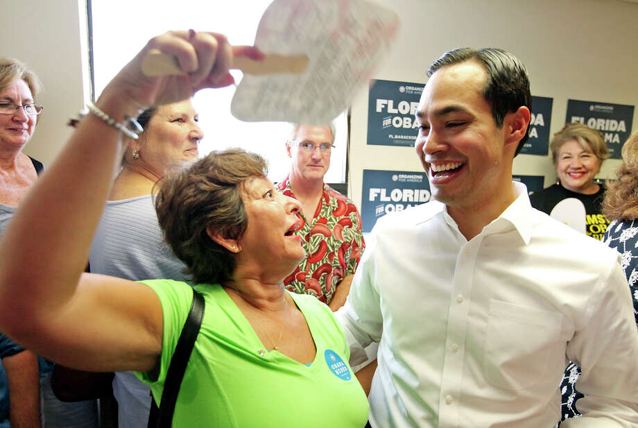 "San Antonio Mayor Julián Castro speaks with Milagros Cummins on Saturday as he campaigns for President Barack Obama in Tampa, Fla. That state is the largest swing state in the nation and carries 29 Electoral College votes. ""Florida is such a special place again,"" Castro said. Photo: Edward A. Ornelas, San Antonio Express-News / © 2012 San Antonio Express-News"