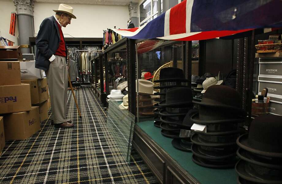 Cable Car Clothiers founder Charles Pivnick checks the merchandise ahead of the new store's opening. Photo: Lacy Atkins, The Chronicle