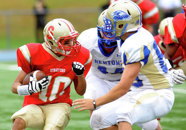 Stratford's #10 Noah Prove runs into Newtown opposition, during football action in Stratford, Conn. on Saturday September 29, 2012. Photo: Christian Abraham / Connecticut Post
