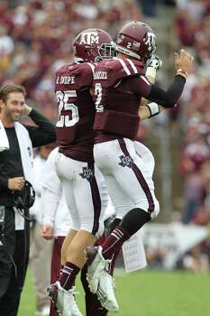 Texas A&M quarterback Johnny Manziel (2) celebrates his touchdown Texas A&M wide receiver Ryan Swope (25) in the fourth quarter of a college football game at Kyle Field, Saturday, Sept. 29, 2012, in College Station. Texas A&M beat Arkansas 58-10. Photo: Karen Warren, Houston Chronicle / © 2012  Houston Chronicle