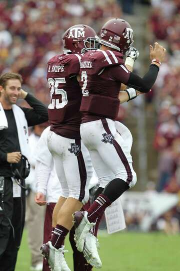 Texas A&M quarterback Johnny Manziel (2) celebrates his touchdown Texas A&M wide receiver Ryan Swope