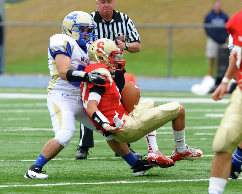 Newtown's #32 Jaret Devellis sacks Stratford QB Michael Cannata, during football action in Stratford, Conn. on Saturday September 29, 2012. Photo: Christian Abraham / Connecticut Post