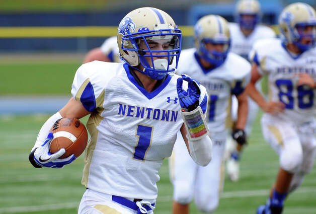 Newtown's #1 Justin Devellis, during football action against Stratford in Stratford, Conn. on Saturday September 29, 2012. Photo: Christian Abraham / Connecticut Post