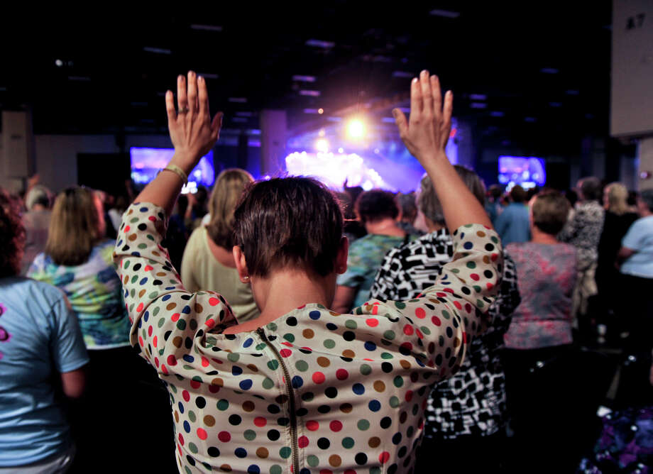 Leah Morris of Fort Hood raises her arms in praise during the Women of Joy Conference Saturday morning, Sept. 29, 2012, at the Henry B. Gonzalez Convention Center. Photo: Robin Jerstad,  For The Express-News
