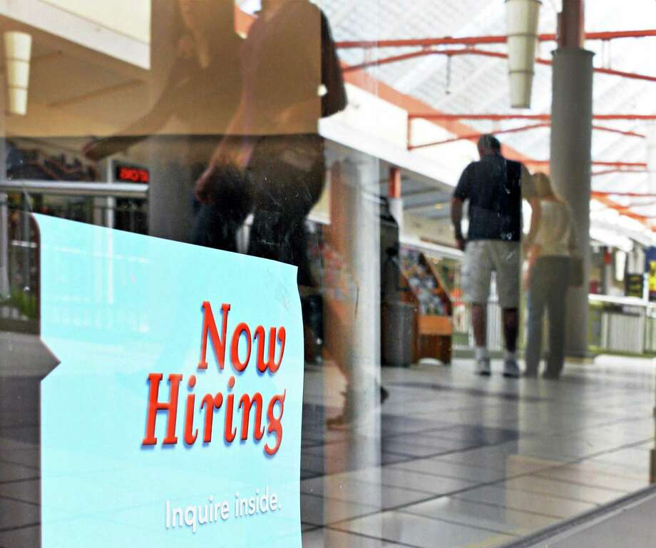 "A ""Now Hiring"" sign in a store window at Crossgates Mall in Guilderland Friday Sept. 21, 2012.  (John Carl D'Annibale / Times Union) Photo: John Carl D'Annibale / 00019346A"