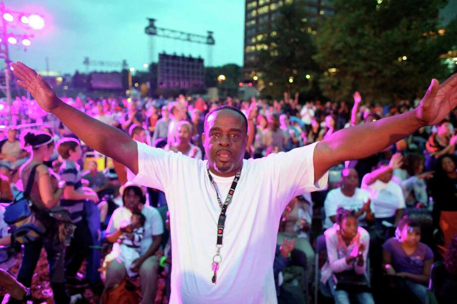 "Oscar Clark extends his arms in prayer while participating in the America for Jesus prayer rally, Friday Sept. 28, 2012, on Independence Mall in Philadelphia. Christian conservatives who blame ""moral depravity"" for everything from the recession to terrorism are converging on Philadelphia for a rally they hope will spark a religious revival as Election Day nears.  (AP Photo/ Joseph Kaczmarek) Photo: Joseph Kaczmarek, Associated Press / FR109827 AP"