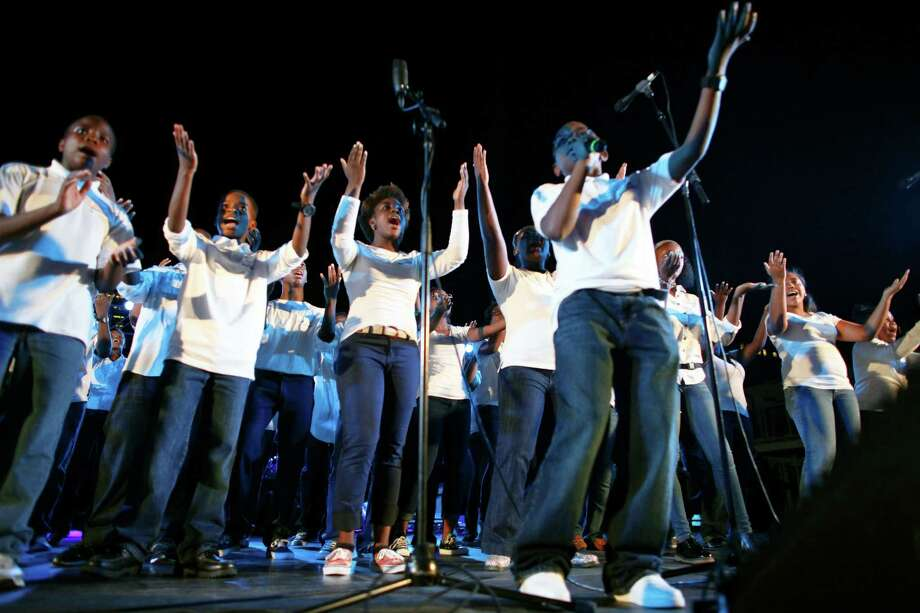 "The America for Jesus Youth Mass Choir performs during the America for Jesus prayer rally, Friday Sept. 28, 2012, on Independence Mall in Philadelphia. Christian conservatives who blame ""moral depravity"" for everything from the recession to terrorism are converging on Philadelphia for a rally they hope will spark a religious revival as Election Day nears.  (AP Photo/ Joseph Kaczmarek) Photo: Joseph Kaczmarek, Associated Press / FR109827 AP"