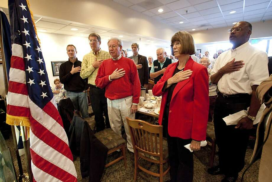 Republicans recite the Pledge of Allegiance before a breakfast meeting in Highlands Ranch, Colo. Photo: Barry Gutierrez, Special To The Chronicle