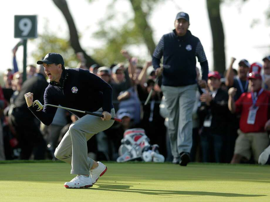 USA's Keegan Bradley reacts after making a putt on the ninth hole during a foursomes match at the Ryder Cup PGA golf tournament Saturday, Sept. 29, 2012, at the Medinah Country Club in Medinah, Ill. Photo: Charlie Riedel, Associated Press / AP