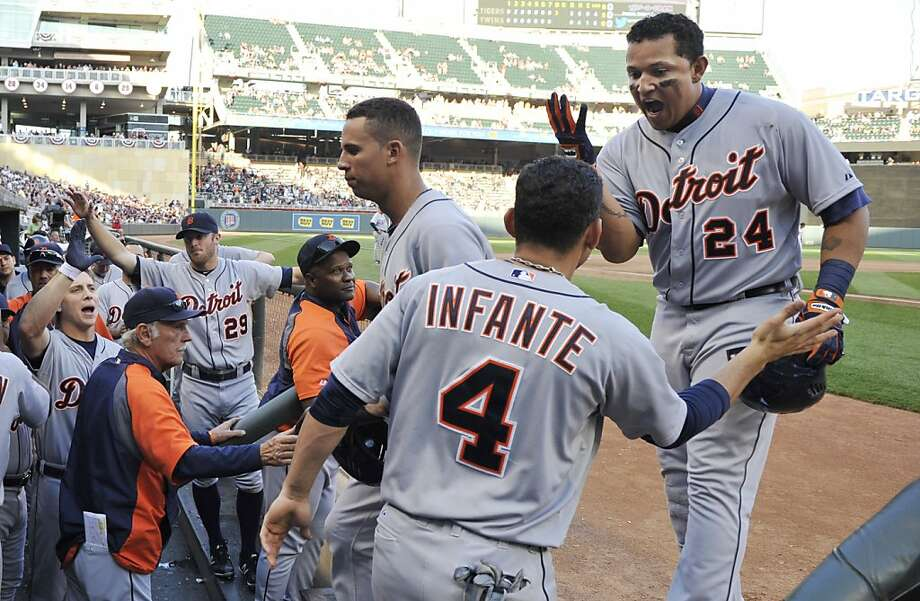 Detroit Tigers' Miguel Cabrera, right, is congratulated in the dugout after his three-run home run off Minnesota Twins' Casey Fien in the eighth inning. Photo: Jim Mone, Associated Press