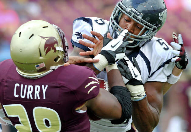 Bobcats running back Marcus Curry battles Wolf Pack defender Duke Williams in the air for possession of a long pass as Texas State hosts Nevada at Bobcat Stadium on September 29, 2012. Photo: Tom Reel, Express-News / ©2012 San Antono Express-News