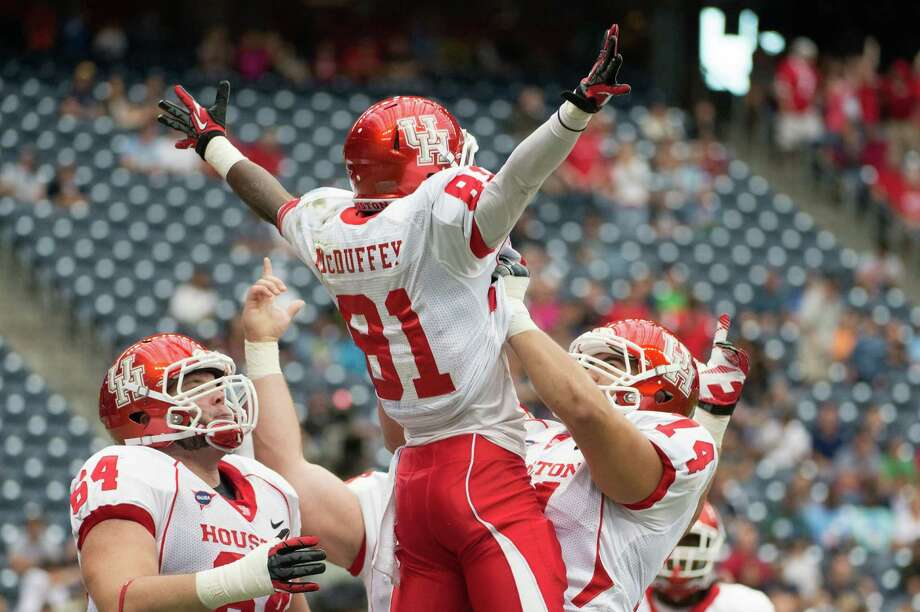 Houston wide receiver Larry McDuffey (81) celebrates with offensive linesman Rowdy Harper (74) after catching a touchdown pass during the first quarter against Rice in the annual Bayou Bucket football game at Reliant Stadium, Saturday, Sept. 29, 2012, in Houston. Photo: Smiley N. Pool, Houston Chronicle / © 2012  Houston Chronicle