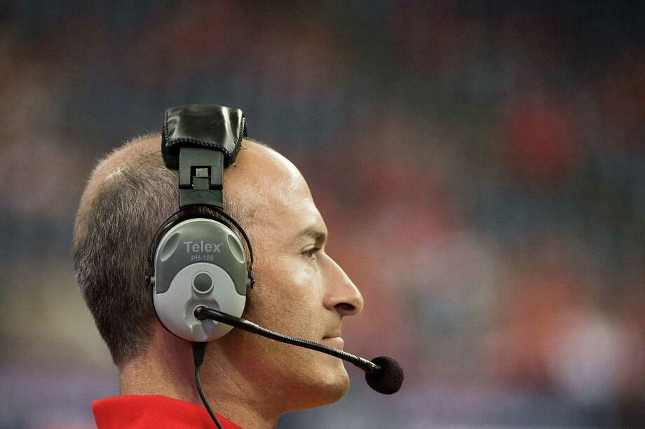 Houston head coach Tony Levine watches during the fourth quarter of the annual Bayou Bucket college football game against Rice at Reliant Stadium, Saturday, Sept. 29, 2012, in Houston. Houston won the game 35-14. Photo: Smiley N. Pool, Houston Chronicle / © 2012  Houston Chronicle