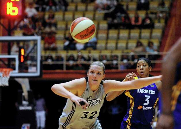 Silver Stars center Jayne Appel and Candace Parker of the Sparks chase after a loose ball during WNBA playoffs action at Freeman Coliseum on Saturday, Sept. 29, 2012. Photo: Billy Calzada, Express-News / © San Antonio Express-News