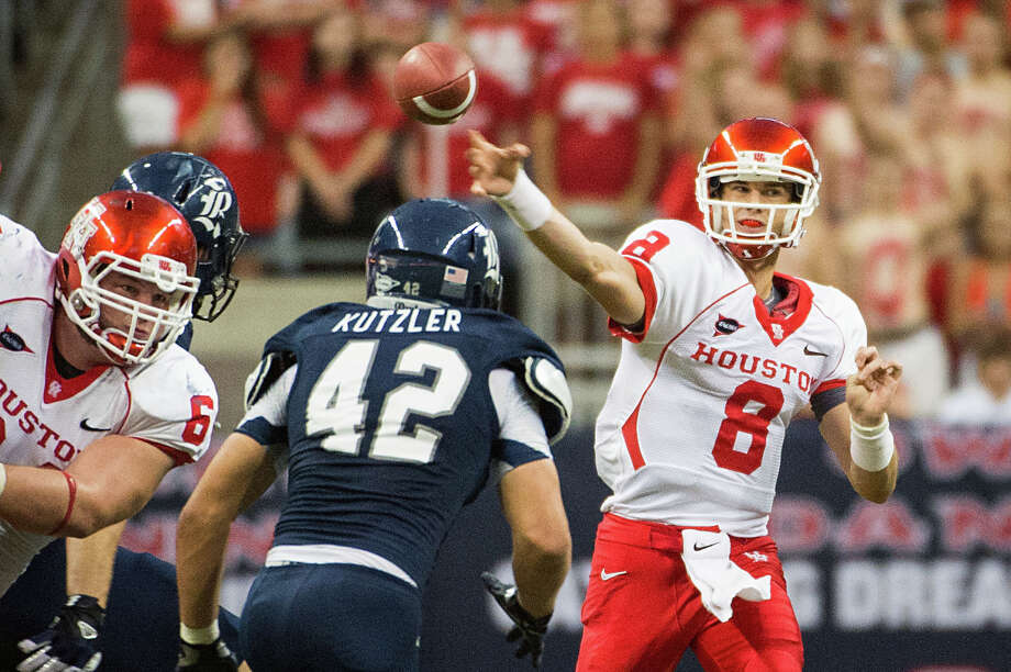 Houston quarterback David Piland (8) throws a pass over Rice linebacker Michael Kutzler (42) during the second half of the annual Bayou Bucket college football game at Reliant Stadium, Saturday, Sept. 29, 2012, in Houston. Houston won the game 35-14. Photo: Smiley N. Pool, Houston Chronicle / © 2012  Houston Chronicle