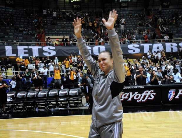San Antonio Silver Stars guard Tully Bevilaqua waves goodbye after the Silver Stars were eliminated from the WNBA playoffs by the Los Angeles Sparks at Freeman Coliseum on Saturday, Sept. 29, 2012. Photo: Billy Calzada, Express-News / © San Antonio Express-News
