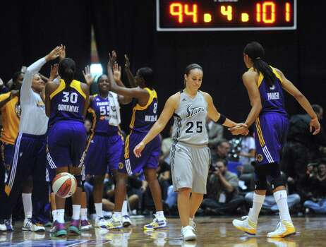 San Antonio Silver Stars guard Becky Hammon (25) leaves the court after the team was eliminated from the WNBA playoffs by their 101-94 loss to the Los Angeles Sparks at Freeman Coliseum on Saturday, Sept. 29, 2012. Photo: Billy Calzada, Express-News / © San Antonio Express-News