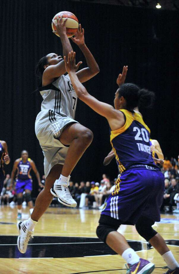 Jia Perkins of the Silver Stars drives as Kristi Toliver of the Los Angeles Sparks defends during WNBA playoffs action at Freeman Coliseum on Saturday, Sept. 29, 2012. Photo: Billy Calzada, Express-News / © San Antonio Express-News
