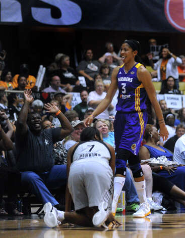 Candace Parker (3) of the Los Angeles Sparks and fans react after Parker hit a three-point half-court shot at the end of the first half during WNBA playoffs action against the San Antonio Silver Stars at Freeman Coliseum on Saturday, Sept. 29, 2012. Photo: Billy Calzada, Express-News / © San Antonio Express-News