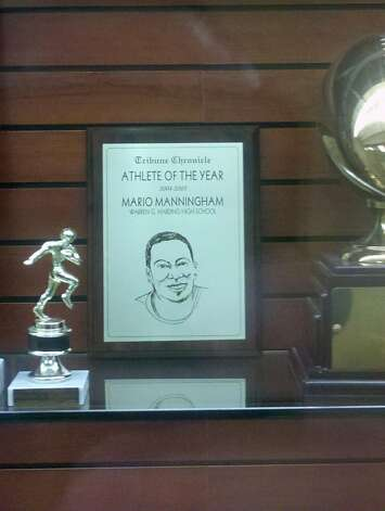 Mario Manningham's 2004-05 Athlete of the Year award in his high school's trophy case. Photo: Eric Branch, The Chronicle