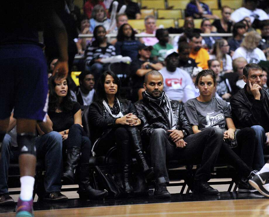 San Antonio Spurs guard Tony Parker, middle, attends the playoff game between the WNBA San Antonio Silver Stars and Los Angeles Sparks at Freeman Coliseum on Saturday, Sept. 29, 2012. Photo: Billy Calzada, Express-News / © San Antonio Express-News