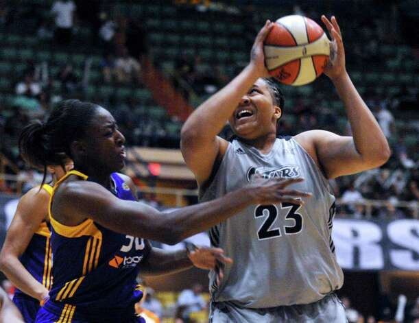 Silver Stars' center Danielle Adams looks for an opening as Nneka Ogwumike of Los Angeles defends during WNBA playoffs action at Freeman Coliseum on Saturday, Sept. 29, 2012. Photo: Billy Calzada, Express-News / © San Antonio Express-News