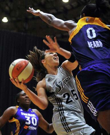 Guard Becky Hammon of the San Antonio Silver Stars goes for a layup as Alana Beard of the Los Angeles Spark defends during WNBA playoffs action at Freeman Coliseum on Saturday, Sept. 29, 2012. Photo: Billy Calzada, Express-News / © San Antonio Express-News