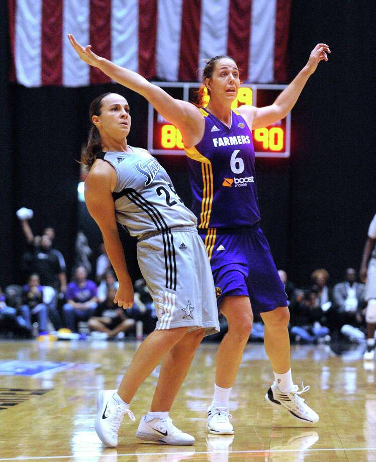 San Antonio Silver Stars guard Becky Hammon seems to use body language to will her shot into the hoop as Jenna O'Hea of the Los Angeles Sparks (6) reacts during second-half WNBA playoffs action at Freeman Coliseum on Saturday, Sept. 29, 2012. Hammon did not make the shot. Photo: Billy Calzada, Express-News / © San Antonio Express-News