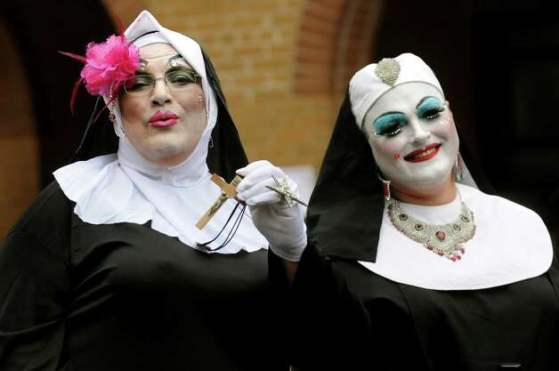 Participants dress in drag as Sister Marilee Rollsalong, left, and Mother Perpetua of the Albany chapter of Sisters of Perpetual Indulgence attend the annual AIDSWalk on Saturday, Sept. 29, 2012, at Washington Park in Albany, N.Y. (Cindy Schultz / Times Union) Photo: Cindy Schultz / 00019454A