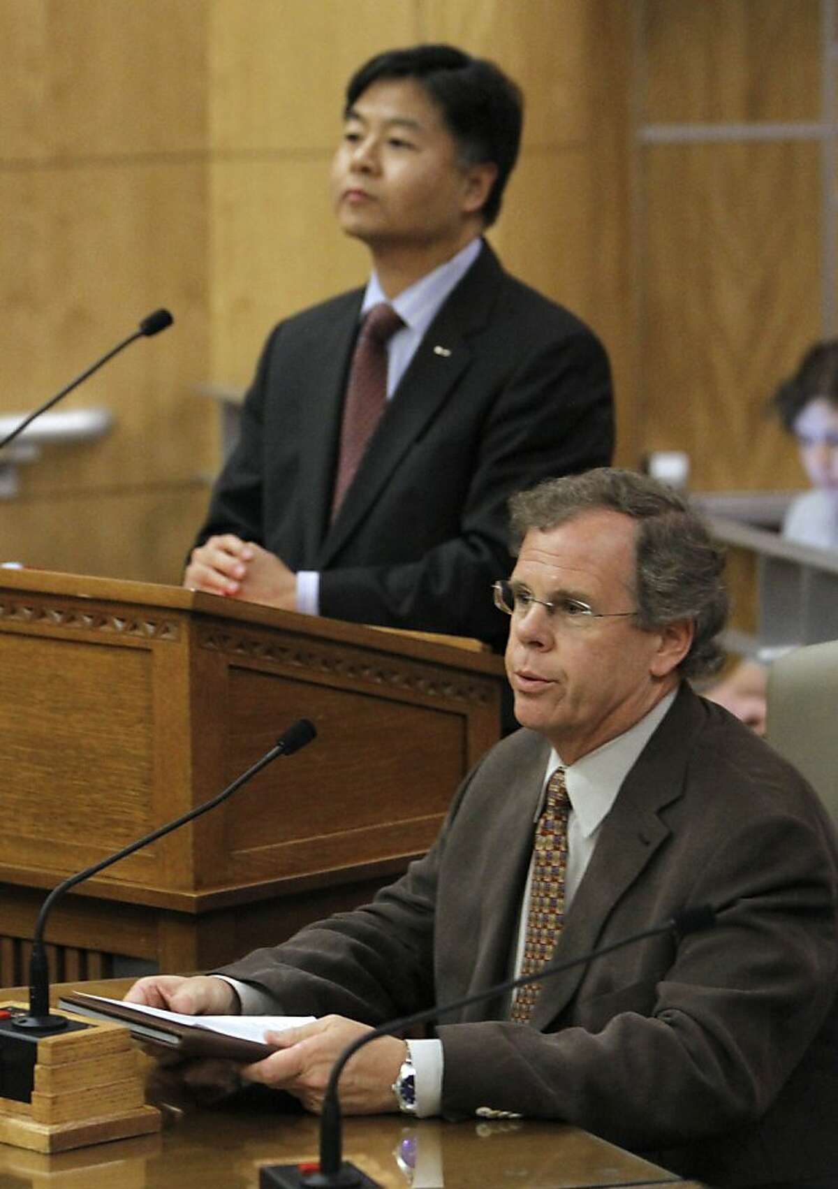 Attorney Peter Drake, executive director of the Coming Out Into Light Foundation, right, speaks about his negative experiences while receiving a controversial form of psychotherapy aimed at making gay people straight, while testifying in favor of a bill to ban the therapy during a hearing at the Capitol in Sacramento, Calif., Tuesday, May 8, 2012. The bill, SB1172, by state Sen.Ted Lieu, D-Torrence, left, would prohibit so-called reparative therapy for minors and obligate adults to sign a release form stating that the counseling is ineffective and possibly dangerous. It was passed by the Senate Judiciary Committee 3-1. (AP Photo/Rich Pedroncelli)