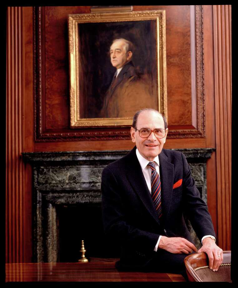 In this 1992 photo, Arthur Ochs Sulzberger poses for a photo in the New York Times boardroom beneath a picture of Arthur Ochs, in New York. In 1896, Ochs acquired control of the New York Times. Former New York Times publisher Sulzberger, who led the newspaper to new levels of influence and profit amid some of the most significant moments in 20th-century journalism, died Saturday, Sept. 29, 2012. He was 86. (AP Photo/The New York Times Archive, Burk Uzzle) MANDATORY CREDIT Photo: Burk Uzzle / The New York Times Archive