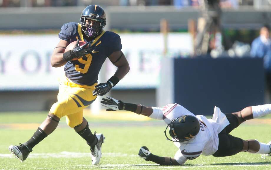 Cal's C.J. Anderson runs around Arizona State's Alden Darby during a game in Berkeley, Calif., on Saturday, Sept. 29, 2012. Arizona State won 27-17. Photo: Mathew Sumner, Special To The Chronicle