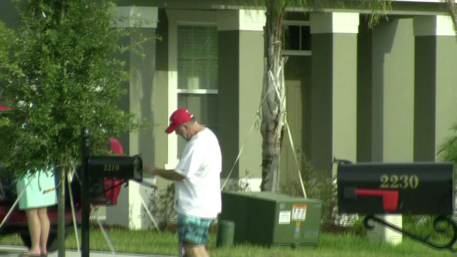 """Albany County Sheriff Craig Apple said his drug unit inspector, John Burke, has """"abandoned"""" the department. Burke, pictured here, retrieves mail last week at his new home near Orlando, Fla. (Times Union)"""