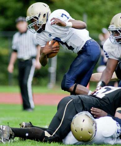 Notre Dame-Fairfield quarterback Glody Tumba tries to stay on his feet during a football game against Joel Barlow High School, played at Barlow. Saturday, Sept. 29, 2012 Photo: Scott Mullin