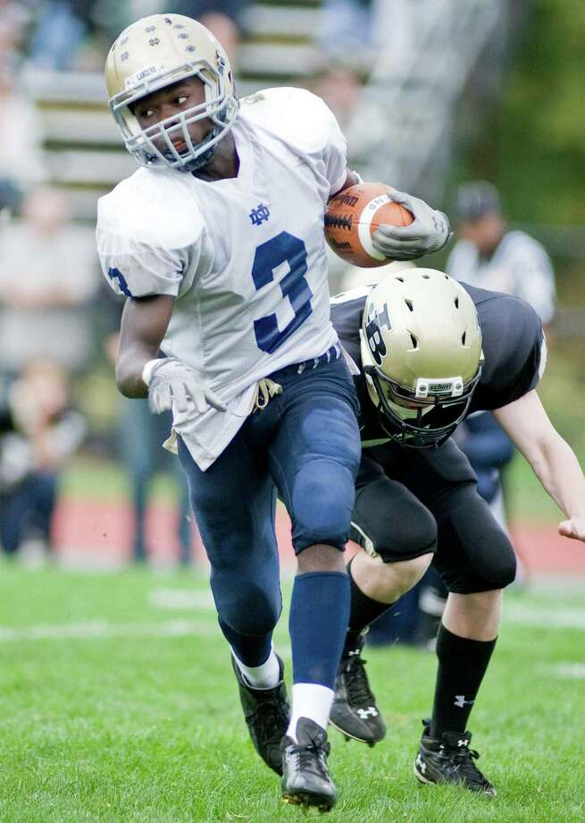 Notre Dame-Fairfield's Marcus Fulton avoids a tackle during a football game against Joel Barlow High School, played at Barlow. Saturday, Sept. 29, 2012 Photo: Scott Mullin / The News-Times Freelance