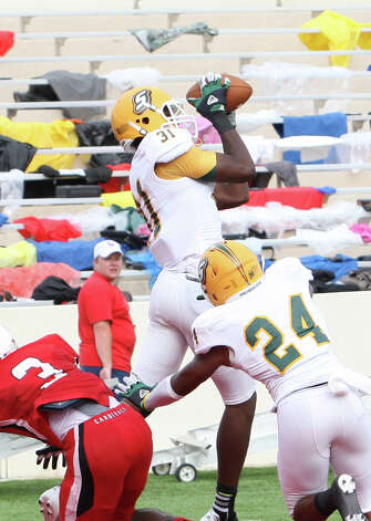 Southeastern's Denzel Thompson, 31, intercepts a pass from Ryan Mossakowski in the endzone at the end of the first half of Lamar's 31-21 loss to Southeastern Louisiana Friday at Provost Umphrey Stadium. Matt Billiot