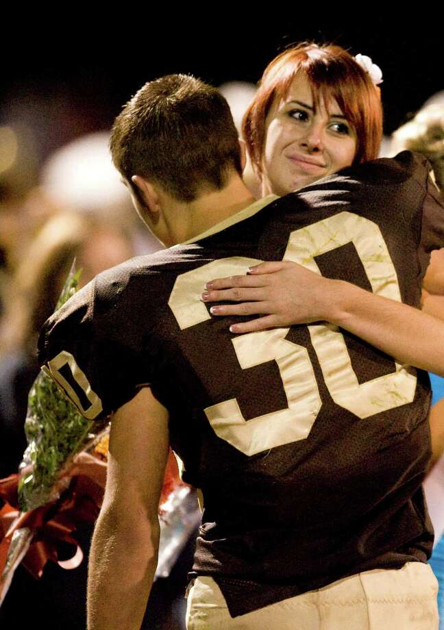Whitney Kropp's hug from football player Josh Awrey was part of a triumphant night for her. Photo: John M. Galloway / Detroit News