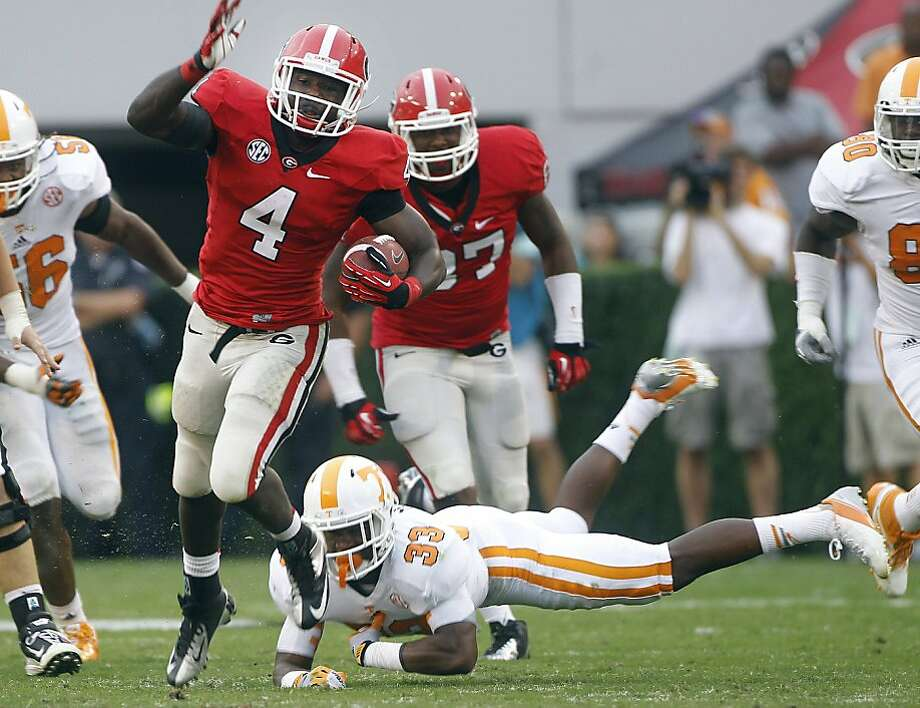 Georgia running back Keith Marshall gets past Tennessee defensive back LaDarrell McNeil (33) for one of his two touchdowns in Athens, Ga. Photo: John Bazemore, Associated Press